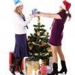 Two Christmas santa girl with gift — Stock Photo #7261817