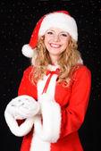 Christmas santa girl on black — Stock Photo