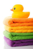 Stack towels and rubber duck — Stockfoto