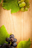 Grape on wooden table — Stock Photo