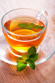 Tea cup with mint — Stock Photo