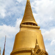 Golden pagoda in Grand Palace Bangkok Thailand - Stock Photo