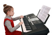 Learning to play on a digital synthesizer — Stock Photo