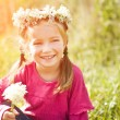 Little girl in wreath of flowers — Stock Photo #6879940
