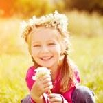 Little girl in wreath of flowers — Stock Photo