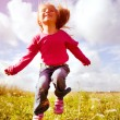 Little girl jumping — Stock Photo #6880042