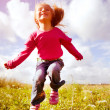 Stock Photo: Little girl jumping