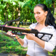 Beautiful young girl with arbalest - Stock Photo