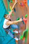 Men climbing on a wall — Stock Photo