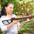 Beautiful young girl with arbalest — Stock Photo
