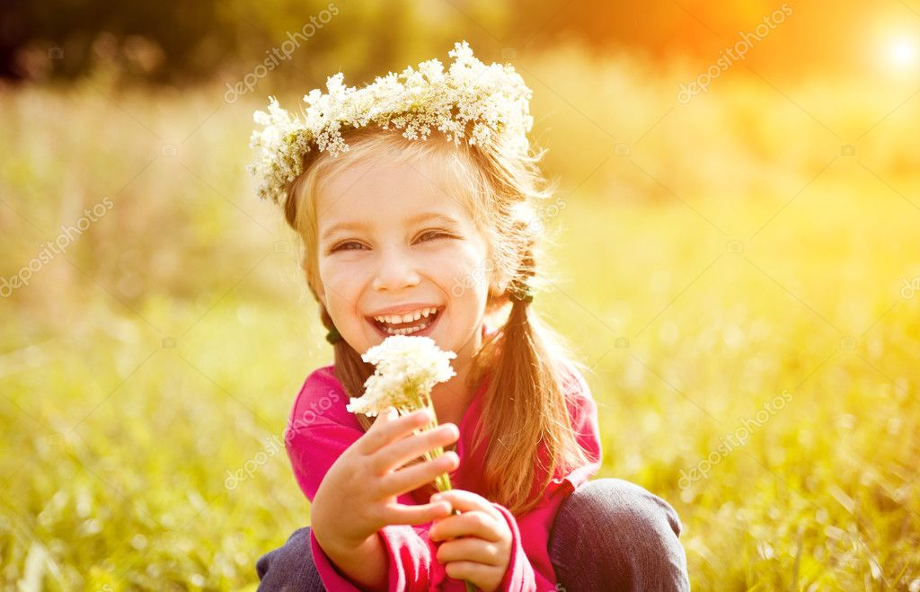 Portrait of a little girl in wreath of flowers — Stock Photo #6947434