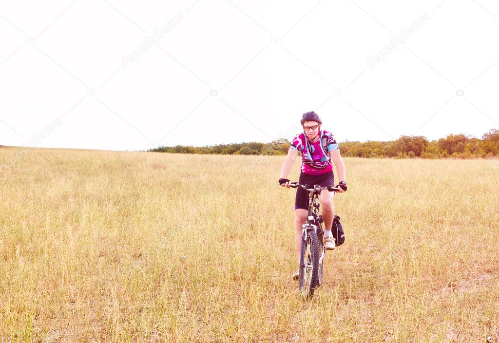 Young sportive man with his black muontain-bike  Stock Photo #6948360