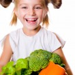 Little girl with the vegetables — Stock Photo #6999752