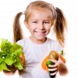 Little girl with the vegetables — Stock Photo #6999864