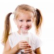 Portrait of a little girl holding a cup of milk — Stock Photo