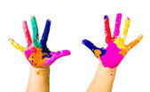 Child hands painted in colorful paints — Stock Photo