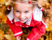 Autumn portrait of a little girl — Stok fotoğraf