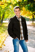 Outdoors portrait of happy young man — Stockfoto