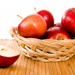 Apples in a yellow basket — Stockfoto