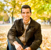 Outdoors portrait of happy young man — Stock Photo