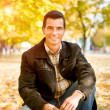 Outdoors portrait of happy young man - Stockfoto