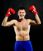 Portrait of young man with boxing gloves — Stock Photo