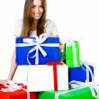 Pretty young woman with gifts - Stock Photo