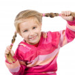 Cute little girl with a plaits — Stock Photo #7332332