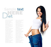 Happy woman demonstrating weight loss — Stock Photo
