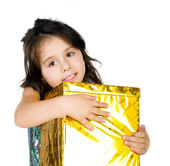 Cute girl with a gift — Stock Photo