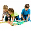 Children are playing letters - Stock Photo