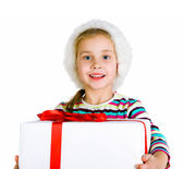 Ittle girl in santa hat with present — Stock Photo