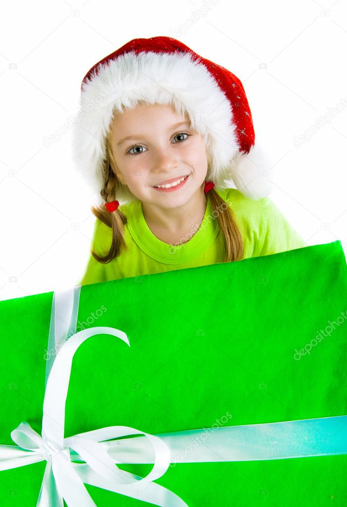 Christmas theme: little girl in santa hat with presents. — Stock Photo #7680598