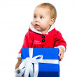 Girl in santa dress with presents — Stock Photo