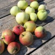 Apples on a wooden table — Stock Photo