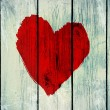 Stock Photo: Love symbol on old wooden wall