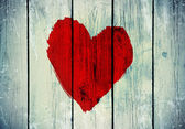 Love symbol on old wooden wall — Stock fotografie