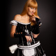 Beautiful caucasian woman dressed in a French Maid costume — Stock Photo
