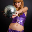 Beautiful young blonde holding a big disco ball — Stock Photo