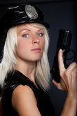 Beautiful sexy police girl with handgun and handcuffs — Stock Photo