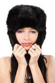 Portrait of a beautiful lady in fur cap — Stock Photo