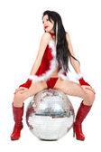 Sexy santa helper with big disco ball — Stock Photo