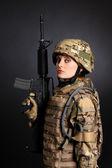 Beautiful army girl with rifle — Stock Photo