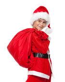 男孩抱着一大袋 — 图库照片