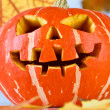 Halloween, old jack-o-lantern on blue — Stock Photo