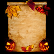 Halloween. Old paper with autumn leaves and pumpkin. - Stock Photo