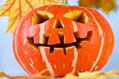 Halloween, old jack-o-lantern on blue — Stock Photo