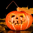 Halloween, old jack-o-lantern on black — Stock Photo #7133348