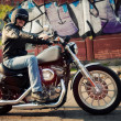 Biker man sits on a bike - Photo