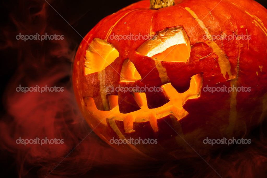 Scary old jack-o-lantern on black background.  Stock Photo #7133361